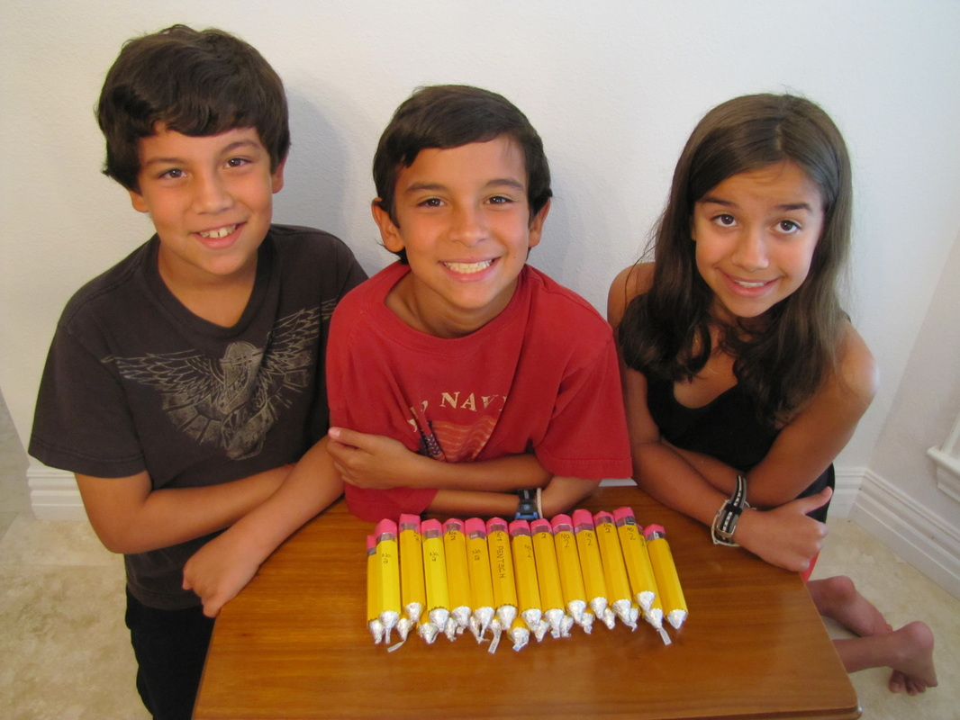 Triplets with pencils made from rolo candy